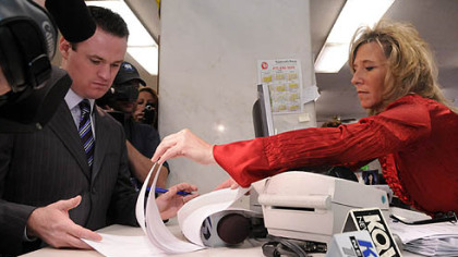 Allegheny County Department of Court Records clerk Laurie Streng, right, shows Pittsburgh Mayor Luke Ravenstahl where to sign the paperwork to temporarily change his name to Steelerstahl.