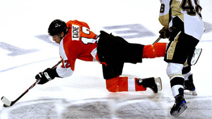 Tyler Kennedy collides with Philadelphia Flyers' Simon Gagne as they go for the puck in the third period last night in Philadelphia.