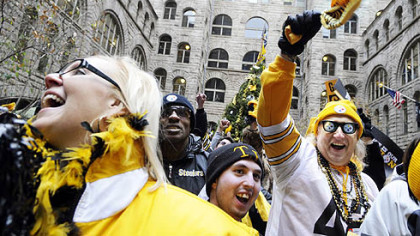Members of Steeler Nation flooded into the courtyard at the Allegheny County Courthouse during a rally yesterday to support the team in its upcoming playoff game against the San Diego Chargers. From left are Michelle Kernan of Moon, Darren Long of Jefferson Hills and, wearing Steelers beads, cap and glasses, Don Zadach of Jefferson Hills.