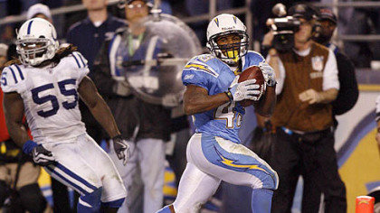 San Diego Chargers running back Darren Sproles, right, scores the winning touch down past Indianapolis Colts linebacker Clint Session in overtime during an NFL AFC wild-card playoff game last Saturday in San Diego.