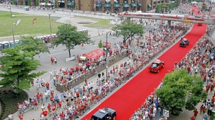 Spectators watch as All-Star players are driven to Busch Stadium before the game.