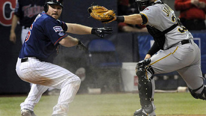 Minnesota Twins Jason Kubel, left, looks for the call after he was tagged out by Pirates catcher Jason Jaramillo after Kubel tried to score from first on a double by Michael Cuddyer in the second inning of last night's game.