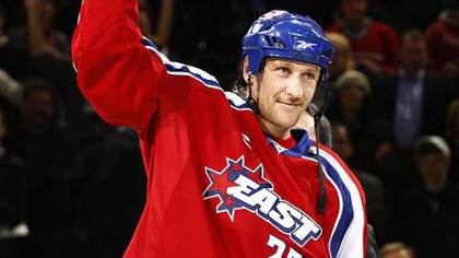 Eastern Conference's Alex Kovalev, of the Montreal Canadiens, holds up the MVP trophy after the game last night.