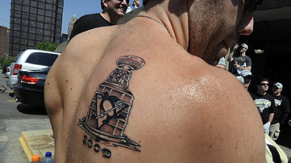 Pascal Dupuis shows off his new tattoo.