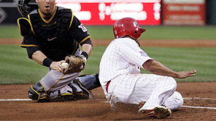Phillies outfielder Shane Victorino beat the tag of Pirates catcher Ryan Doumit to score on a single by second baseman Chase Utley in the third inning of last night&#039;s game.