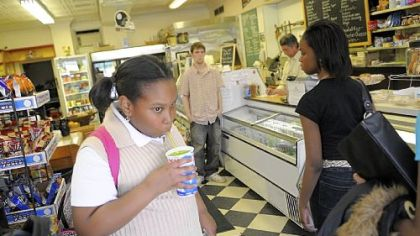 Tyler Randolph, 11, stops in at the Frick Park Market on the way home from school to drink a lemon-lime slushie.