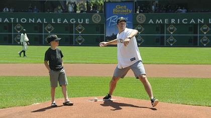 Bill Guerin throws out the ceremonial first pitch at the Pirates game yesterday at PNC Park.