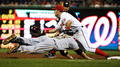 Freddy Sanchez slides to first base  as Washington Nationals' first baseman Nick Johnson make the play and out during the seventh inning of last night's game in Washington.