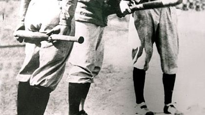 The Pirates' Honus Wagner and the Tigers' Ty Cobb, right, test a baseball bat during the 1909 World Series.