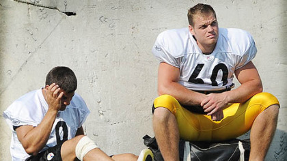Punter Daniel Sepulveda, left, sits out the afternoon practice at Saint Vincent College at camp last year the day after his injury.