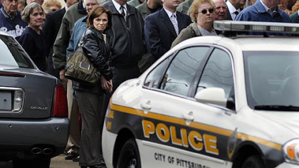 Pittsburgh police officers and the public lined up at Winter Funeral Home in Bloomfield to pay their respects to officer Paul J. Sciullo II, who was killed Saturday.