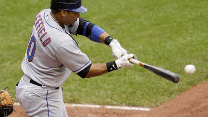 Mets outfielder Gary Sheffield drives in teammate Alex Cora with a fifth-inning single off Pirates pitcher Paul Maholm yesterday.