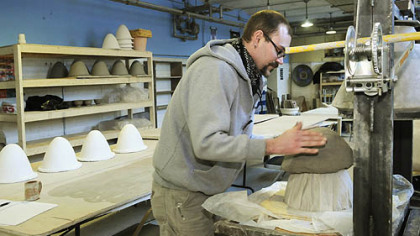 Jeff Schwarz places a clay mixture on the mold, forming a cone. The cone is fired at 1,700 degrees. When finished, it acts as a natural filter for contaminated water.