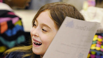 "First-grader Cassidy Concanon receives a ""Whale Done"" award during morning assembly at Schaeffer school. She was noted by classmate Abby Fontana  for being a ""good friend"" and helping her with ""reading and math."""