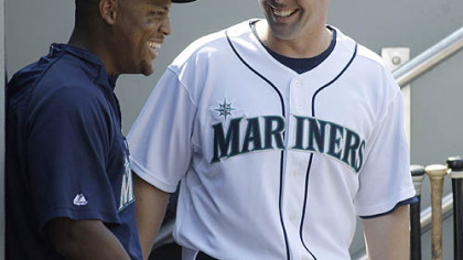 Mariners third baseman Adrian Beltre, left, visits with new Mariners shortstop Jack Wilson, right, after he arrived in the dugout during their game against the Toronto Blue Jays yesterday at Safeco Field in Seattle.