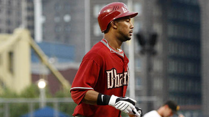 Diamondbacks outfielder Chris Young trots home past Pittsburgh Pirates pitcher Zach Duke after hitting a two-run home run in the fourth inning.