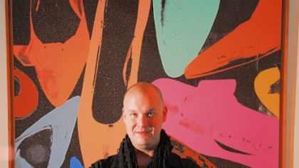 Newly appointed Warhol Museum curator Eric Shiner with Warhol&#039;s &quot;Diamond Dust Shoes.&quot;