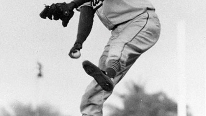 Satchel Paige winds up for the pitch against the Montreal Royals in the second game of the doubleheader April 29, 1956 in Miami.