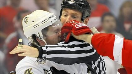 Matt Cooke takes a left from Detroit's Johan Franzen during one of the many third-period scrums.