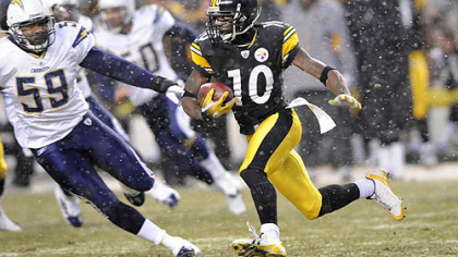 Santonio Holmes returns a punt back for a touchdown in the first quarter against the Chargers Sunday.