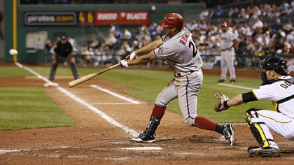 Diamondbacks outfielder Alex Romero hits a two-run RBI double in the 12th inning.