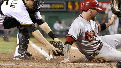 Pirates catcher Jason Jaramillo loses the ball as he attempts to tag Diamondbacks infielder Ryan Roberts in the eighth inning.