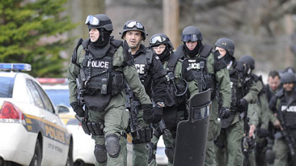 Pittsburgh police file up Fairfield Street following a deadly stand-off in Stanton Heights today,.