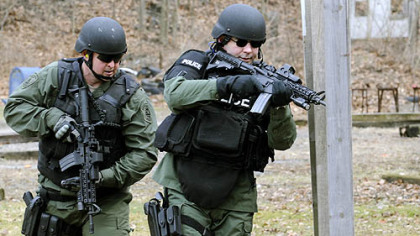 City SWAT members William Friburger and Donald Savko practice at the shooting range in Highland Park. The team's performance in a sniper competition last year will air on the Military Channel tomorrow and Tuesday nights.