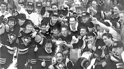 "The Penguins celebrate around the Stanley Cup after their 1991 victory. ""When you look back on the whole career, the main goal, the reason you play the game, is to win the Stanley Cup. It's the ultimate prize."" -- Joe Mullen"