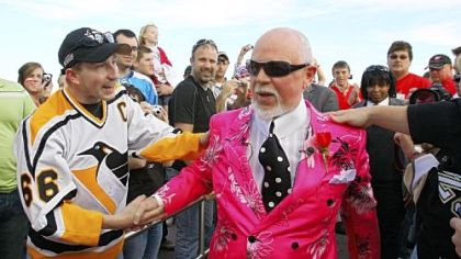 CBC analyst Don Cherry, sporting a customary loud outfit, greets a Penguins fan as he enters Joe Louis Arena for last night's Game 2 in Detroit.