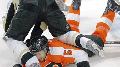 Evgeni Malkin goes tumbling over Philadelphia's Braydon Coburn in front of the Flyers' net.