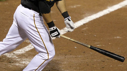 Pirates outfielder Garrett Jones follow through on a walk-off 14th-inning solo home run off Giants pitcher Bob Howry.