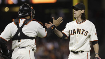 Giants pitcher Tim Lincecum, right, and catcher Bengie Molina celebrate the Giants&#039; win.