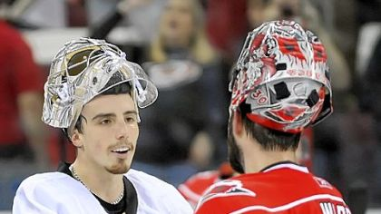 Goalie Marc-Andre Fleury shakes hands with Hurricanes goalie Cam Ward after defeating Carolina last night at the RBC Center in Raleigh, N.C.