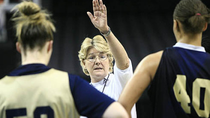 Pitt's coach Agnus Berenato talks to Kate Popovec, left, and Pepper Wilson, right, during practice in Oklahoma City, Saturday.
