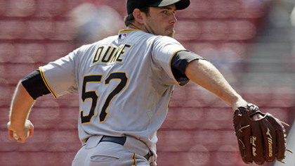 Pirates pitcher Zach Duke pitches against the Cincinnati Reds during the first inning.