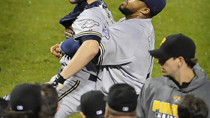 Brewers catcher Jason Kendall is held back by first baseman Prince Fielder during a bench- clearing incident in the eighth inning.