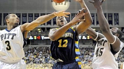 Jermaine Dixon and DeJuan Blair fight for a loose ball with Marquette's Dwight Burke in the second half last night.