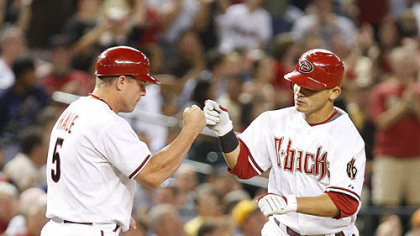 Diamondbacks outfielder Gerardo Parra, right, gets a high five from third base coach Chip Hale after hitting a two-run home run in the fifth inning.