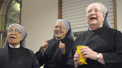 Sister Monique, left, Sister Rosemary, center, and Mother Mary Vincent watch a play unfold during the first half of the Super Bowl at the Little Sisters of the Poor senior care facility on the North Side last night.