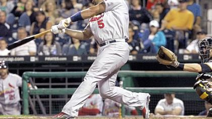 Albert Pujols connects with the winning home run against the Pirates in the 10th inning last night at PNC Park.