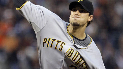 Pirates pitcher Charlie Morton works against the Giants during the third inning of last night's game in San Francisco.