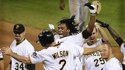 The Pirates' Andrew McCutchen celebrates with Jack Wilson after knocking in the winning run in the ninth inning against the Indians, June 25, 2009.