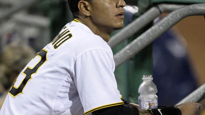 Pirates shortstop Ronny Cedeno watches the final out.