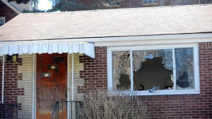The front picture window is broken out at the Poplawski home at 1016 Fairfield St., Stanton Heights.
