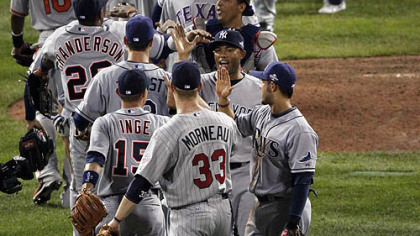 American League players congratulate each other after defeating the National League, 4-3.