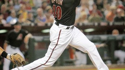 Justin Upton gives Arizona an early lead with a two-run homer in the fourth inning last night.
