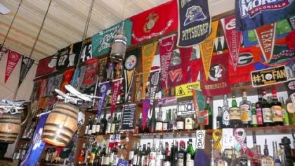 The interior of La Botticella is adorned not only in Steelers paraphernalia, but the banners of Western Pennsylvania colleges, too.