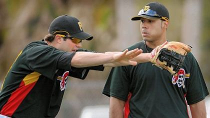 Former No. 1 Pirates prospect Neil Walker, left, talks with current No. 1 prospect Pedro Alvarez during drills at third base in February in Bradenton, Fla.