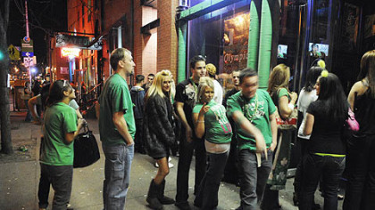 St. Patrick&#039;s Day revelers line up to get into Town Tavern on the South Side last week.